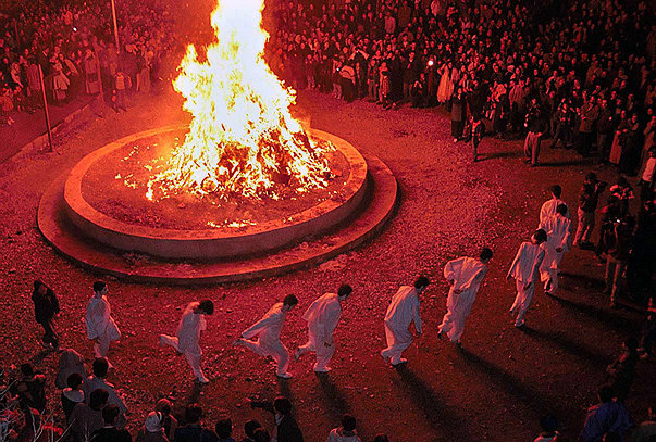 "Iranian Zoroastrian dancing round a fire during celebration of ""Sade-h"" in Tehran. This is a traditional celebration for Zoroastrians every year in Jan30 becuse in this day Fire was discovered by Iranian people tens of thousands years ago.Sunday Jan 30,2000 (AP Photo/Hasan Sarbakhshian)"